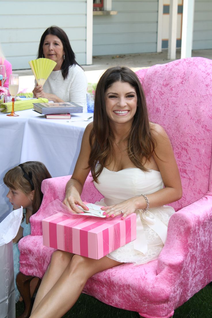 bride opening gifts at shower