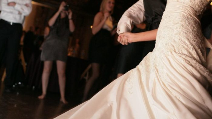 This couple is performing a dramatic dance at their wedding reception.