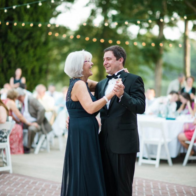 mother of the groom with groom dancing