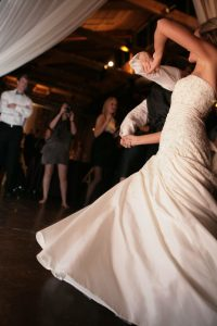 bride in strapless dress dances to her first dance
