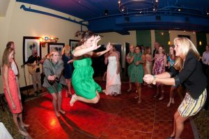 bridesmaid in green dress dancing energetically