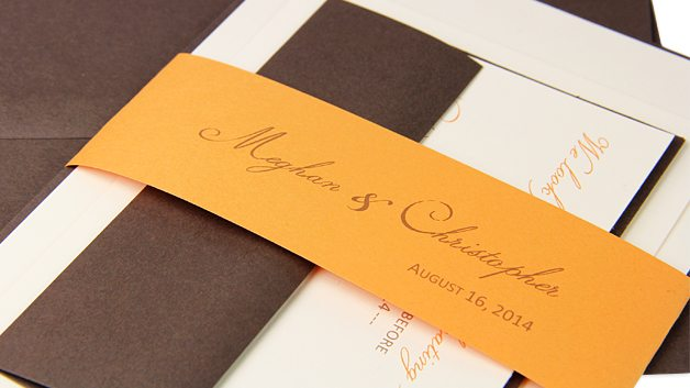 Orange, cream, and brown invitation suite with personalized paper band