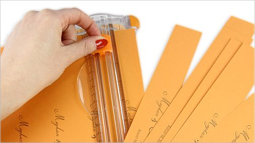 use paper trimmer to cut personalized bands
