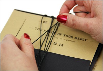 wrap black twine aroudn invitation and response card