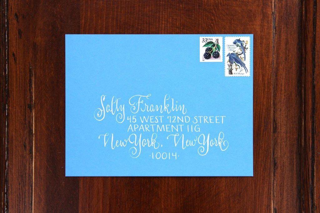 white printed calligraphy bridal shower envelope