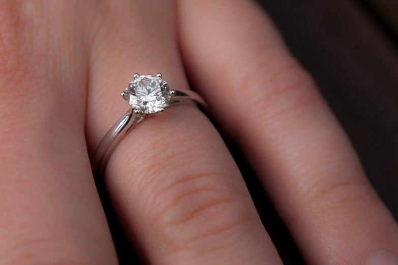 Showing engagement ring