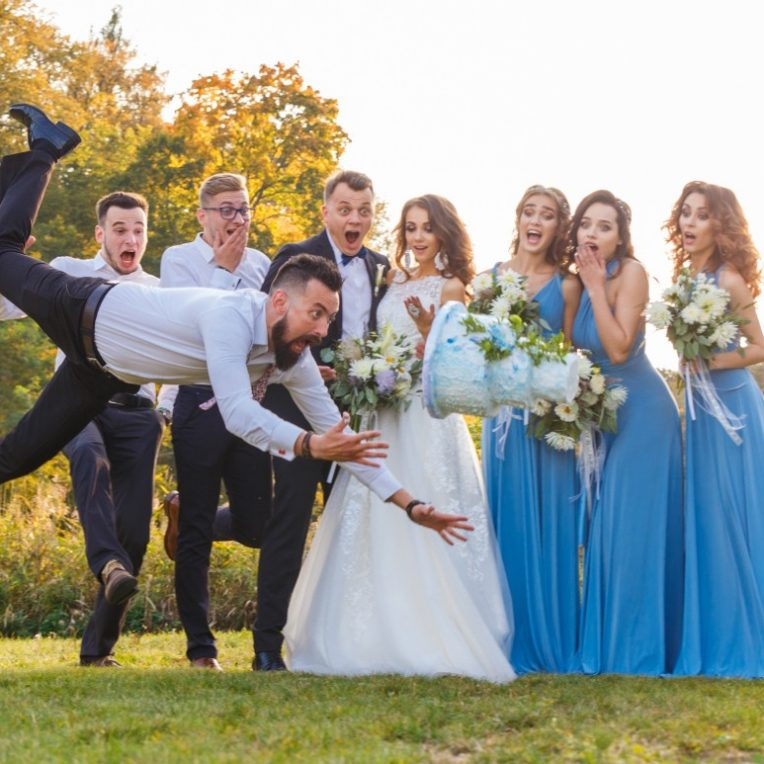 Funny picture of the bridal party in grassy sunset