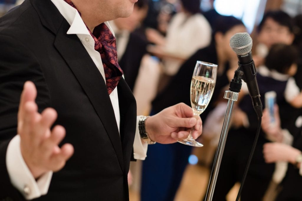 Father giving speech with champagne