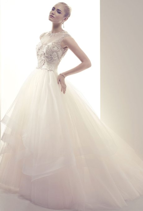 """Valentine's Day is full of blushing pinks, sexy reds, texture princess style and swirling bouts of romance and glam. And that's just what these wedding gowns all have in common. Let's take a look at some dresses inspired by the day when you're supposed to say, """"I love you."""""""