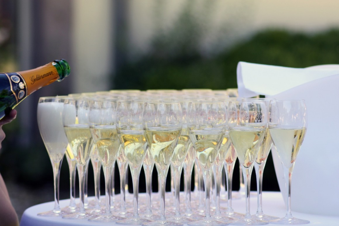 Champagne glasses at wedding being filled.