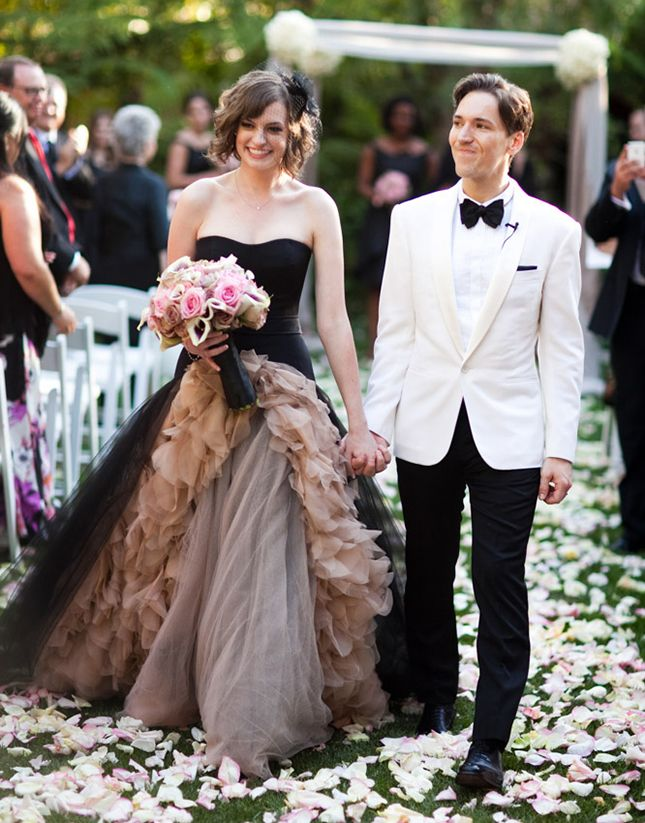 9651aa19c14a Even black wedding gowns can withstand the test of traditionally bridal  features.