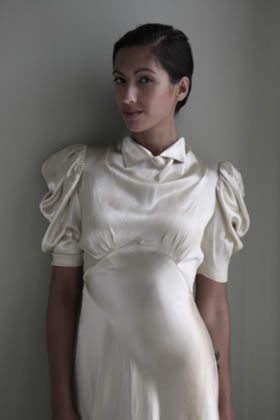 Mother dress is considered a vintage gown for What is considered antique