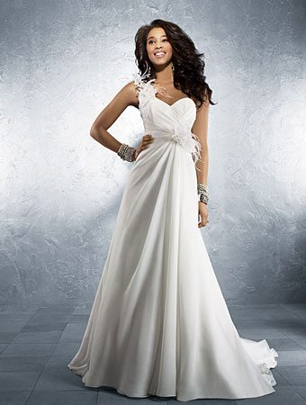 one shoulder bridal gown and different styles of lace