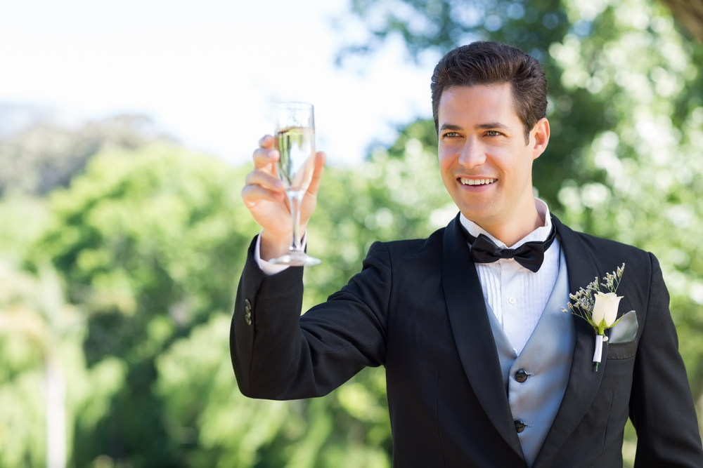 Brother of bride toasting couple