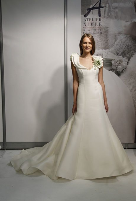 And This Modern Architectural Gown Is Highlight Will Some Green Petals Right At The Shoulder