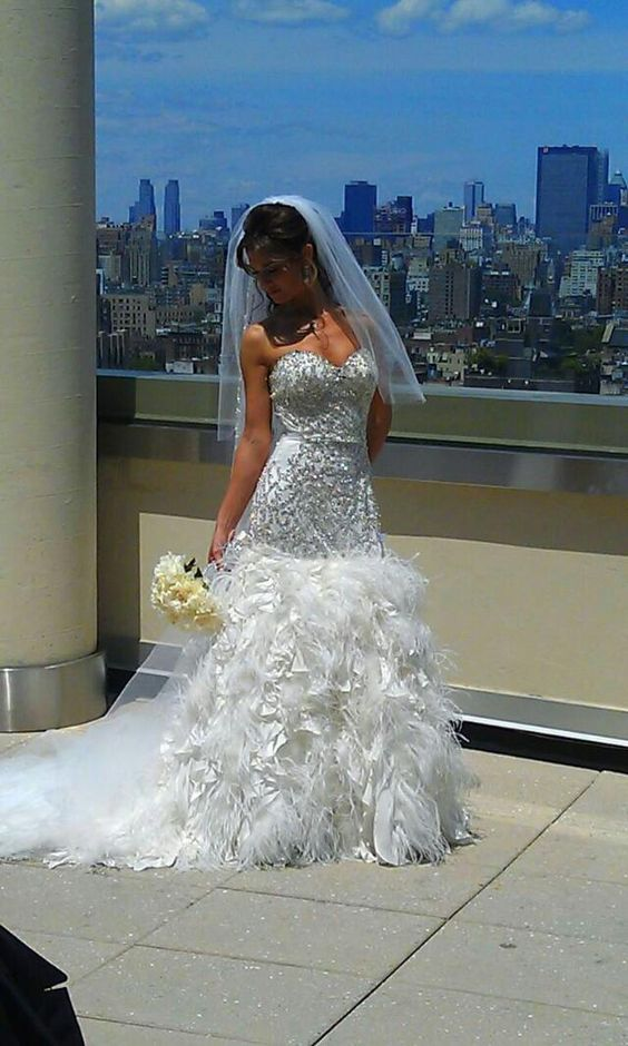 Check Out This Mermaid Style Gown That S Filled With Personality Feather On The Bottom