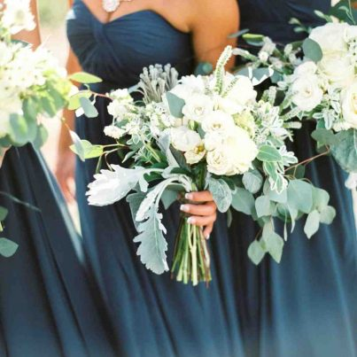 Bridesmaids holding intricate bouquets of flowers