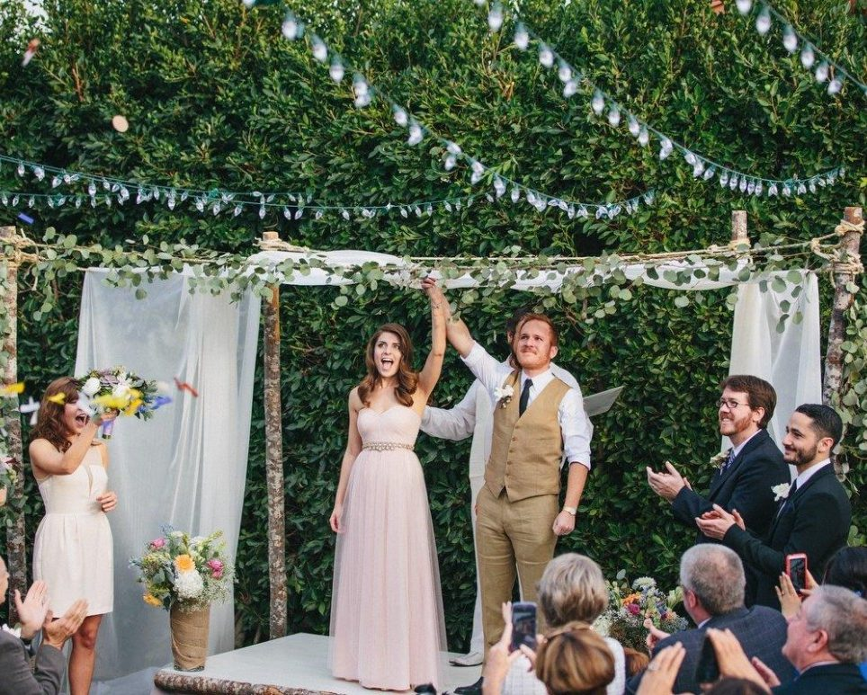 Bride and Groom getting married in a backyard wedding themed celebration
