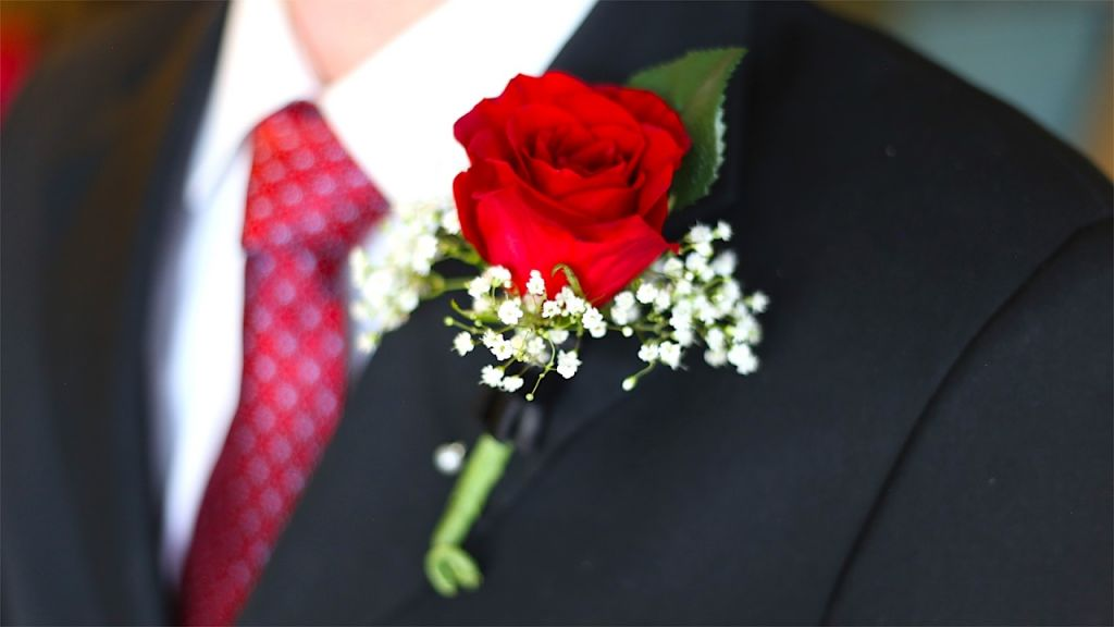 Red Boutonniere on Lapel