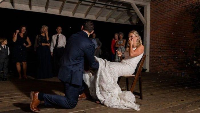 The Garter Toss event at a wedding reception