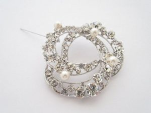 swirled rhinestone brooch