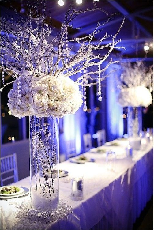frosty wedding centerpiece with branches and vases