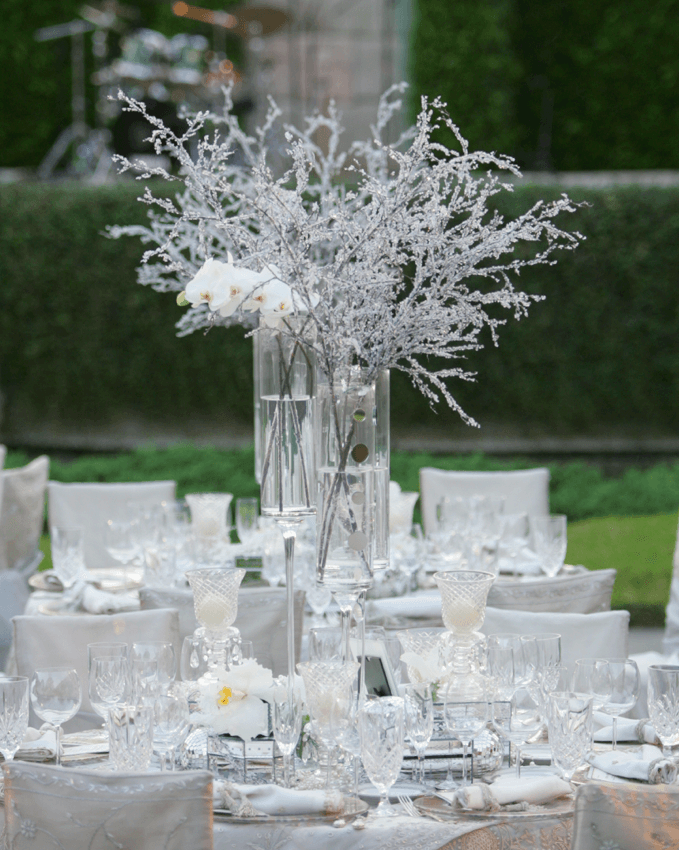frosty centerpiece with icy branches and glass vase