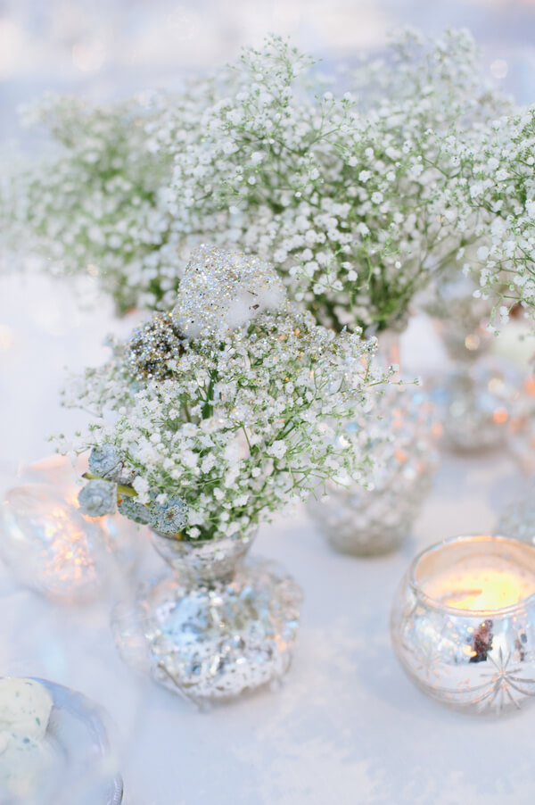 mini frosty centerpieces with baby's breath and tinsel