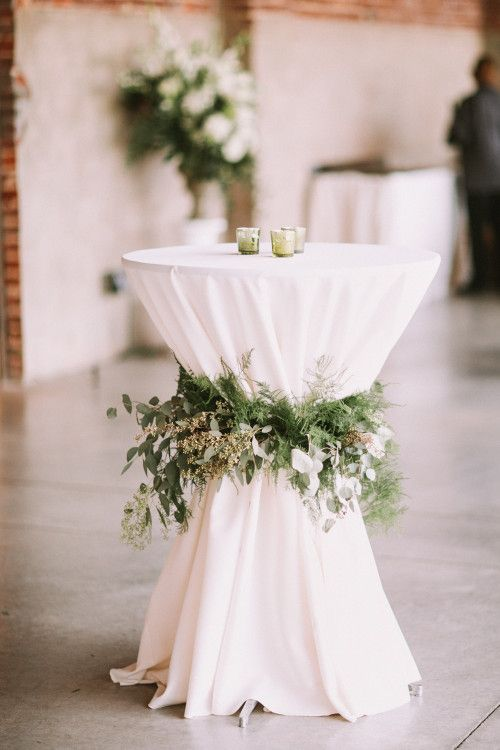 green wedding reception decor cocktail tables
