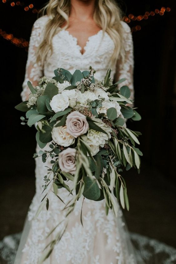 neutral roses with lush greenery wedding bouquet