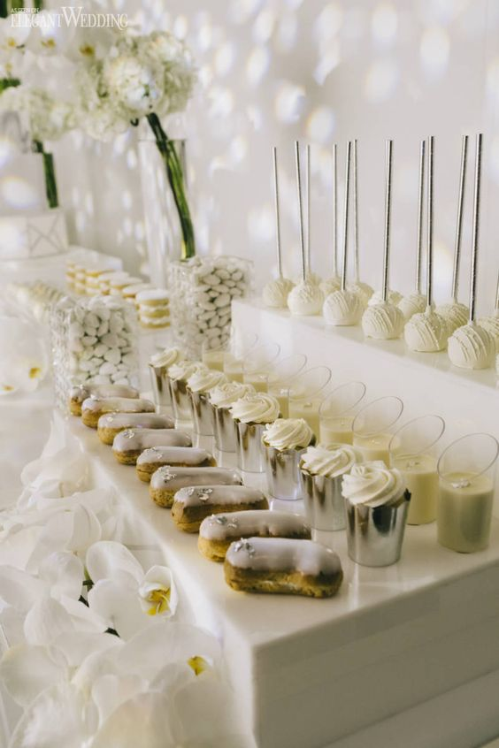all white wedding reception food table