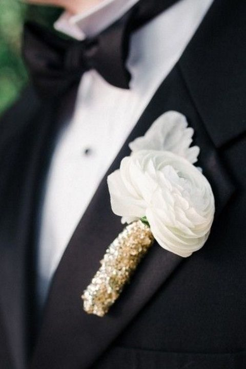 black and gold wedding boutonniere