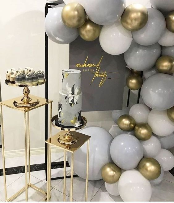 grey and gold wedding cake and decor