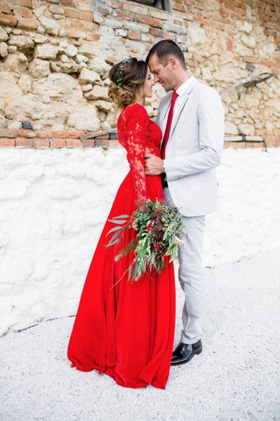 red and white wedding bride and groom