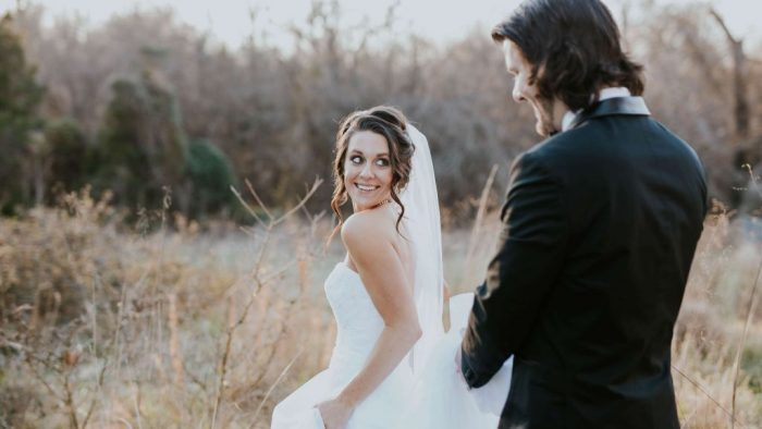 Why can't the groom see the bride's dress before the wedding?