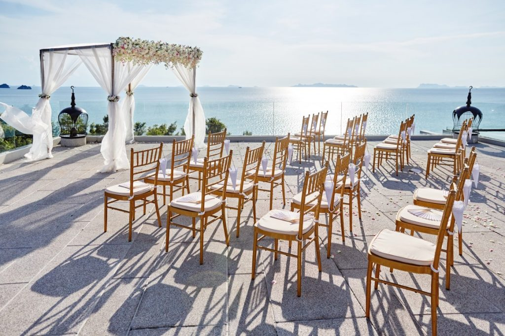 wedding ceremony chairs on the ocean