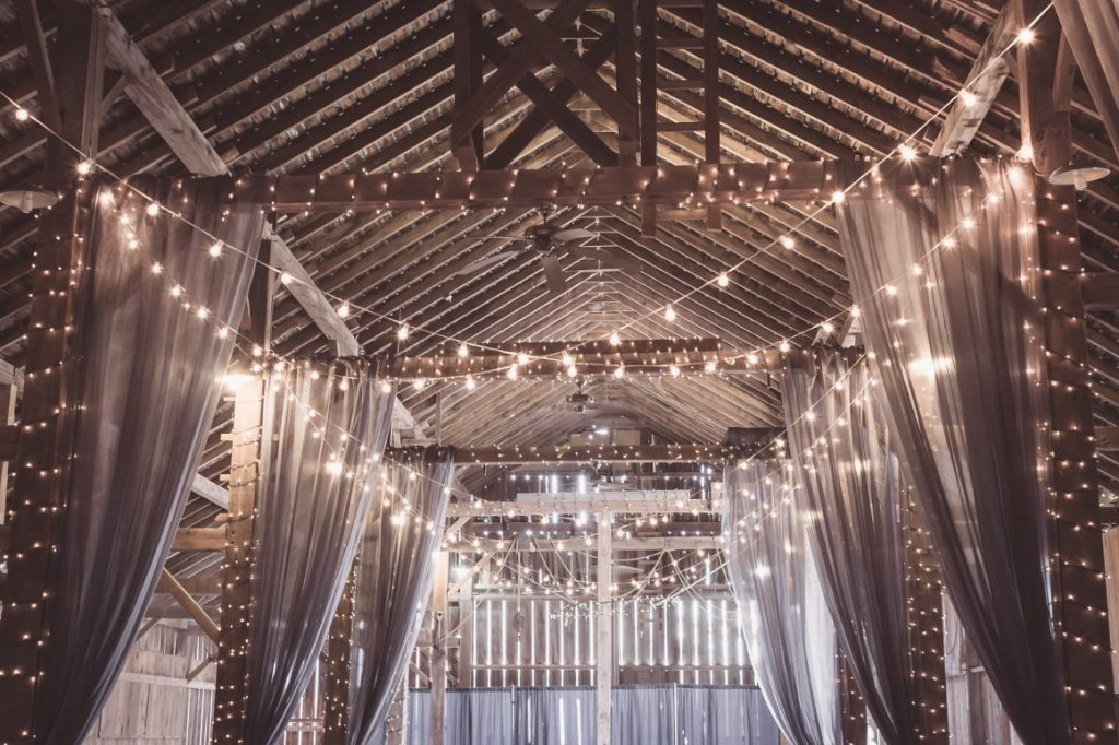 barn wedding with string lights draping over reception