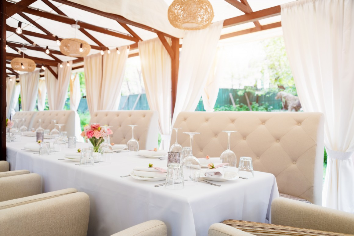 outdoor long table white white linen and ivory couches
