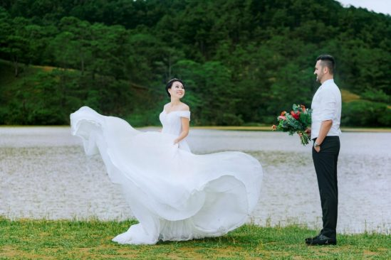 Photo of newlyweds next to river