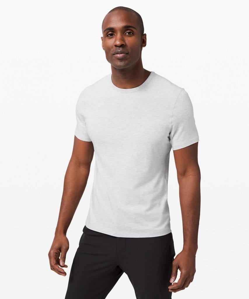 male model wearing white Lululemon tshirt