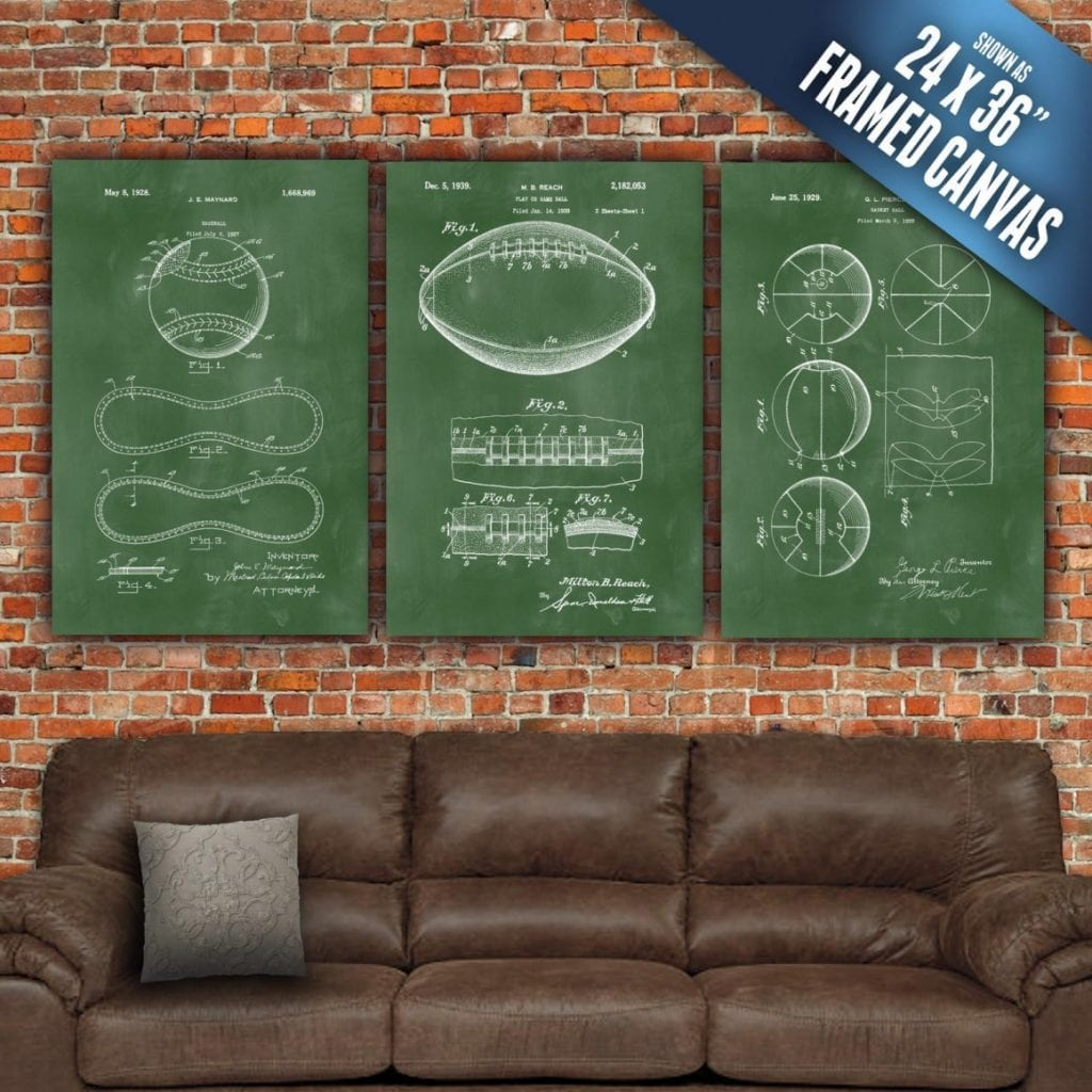 sports prints on brick wall above leather couch