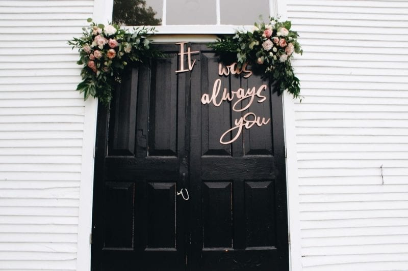 door with wedding signage