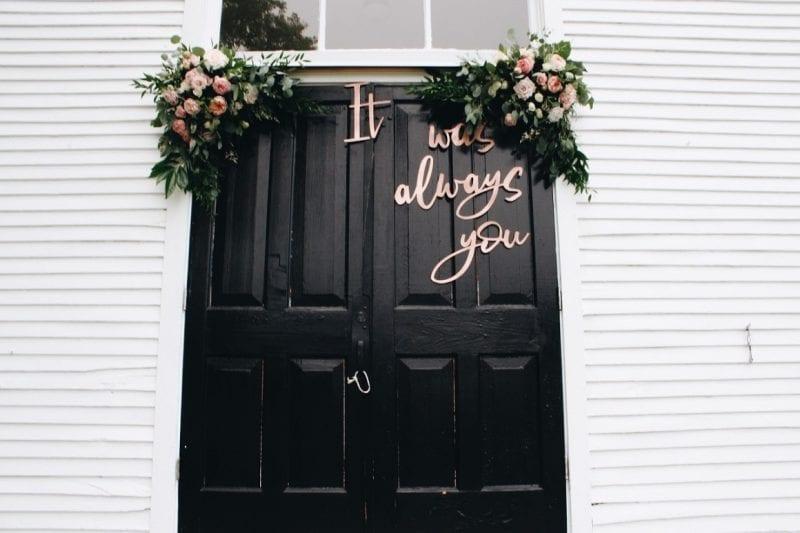 door with wedding signage