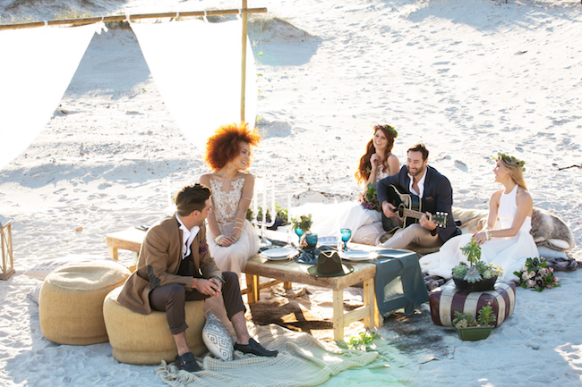 Wedding attendees on the beach in various attire