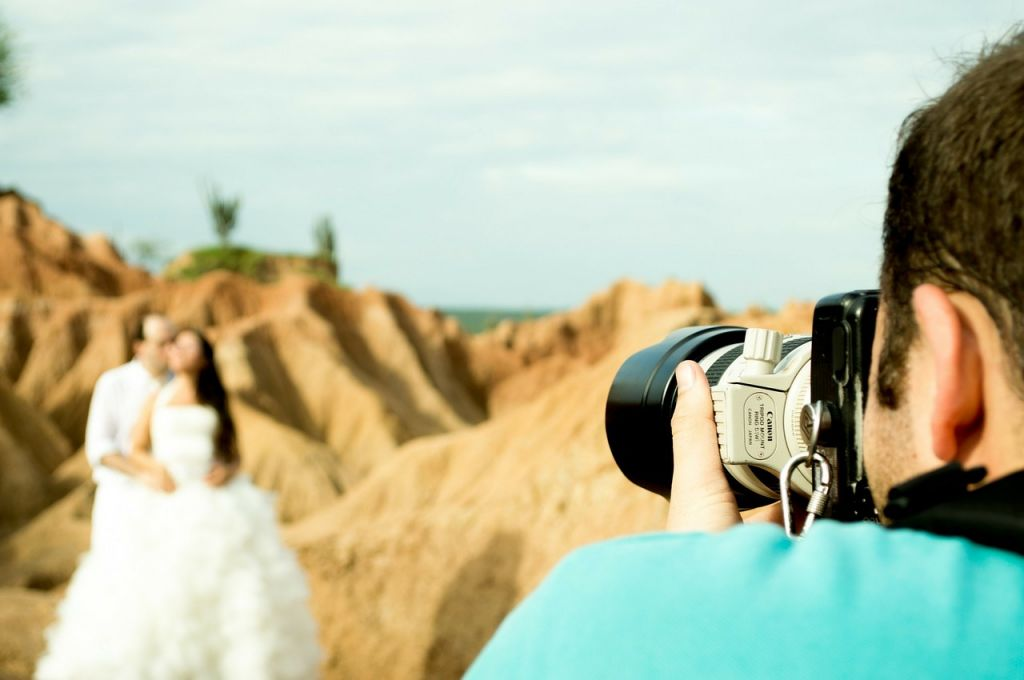 Photographer and couple at wedding shoot