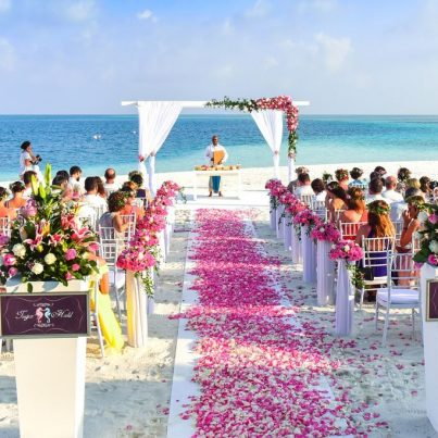 A wedding ceremony being held on a beach