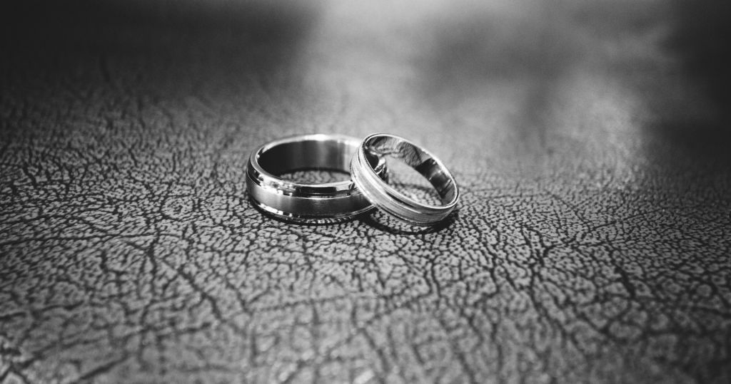 Black and white photo of wedding bands
