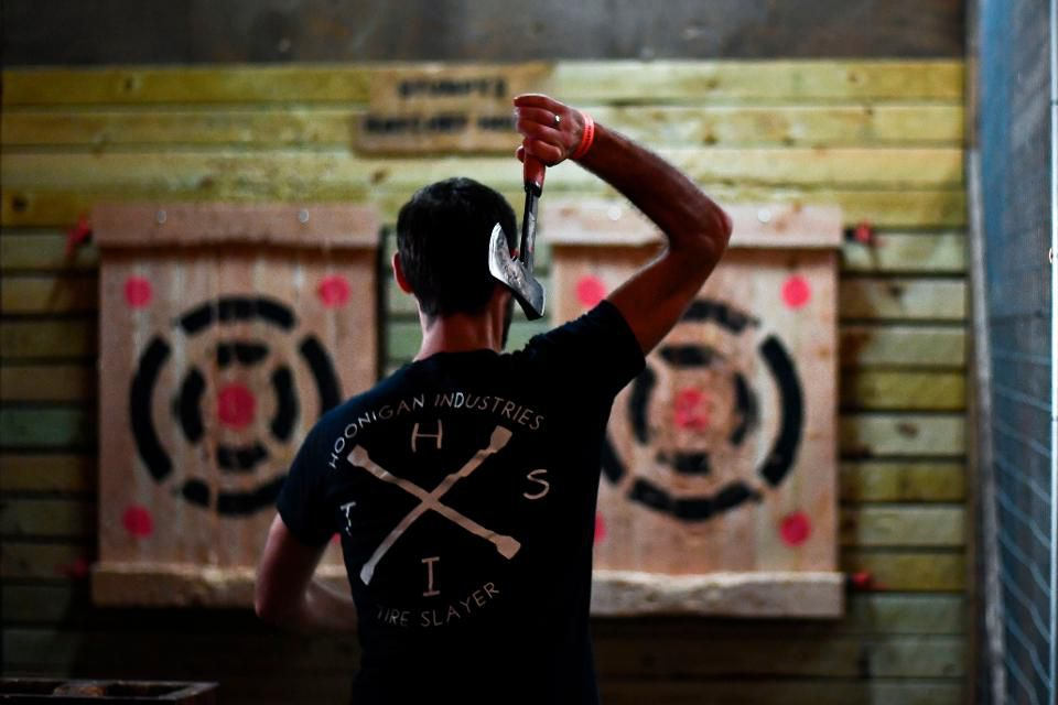 Man at an axe throwing activity