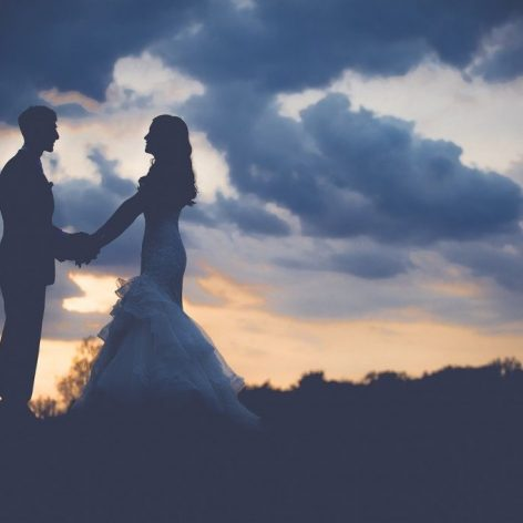 Bride and groom with sunset in background