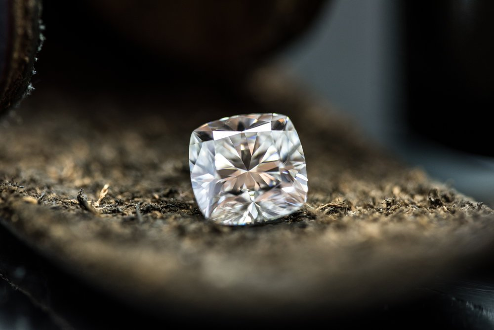A diamond resting on table top